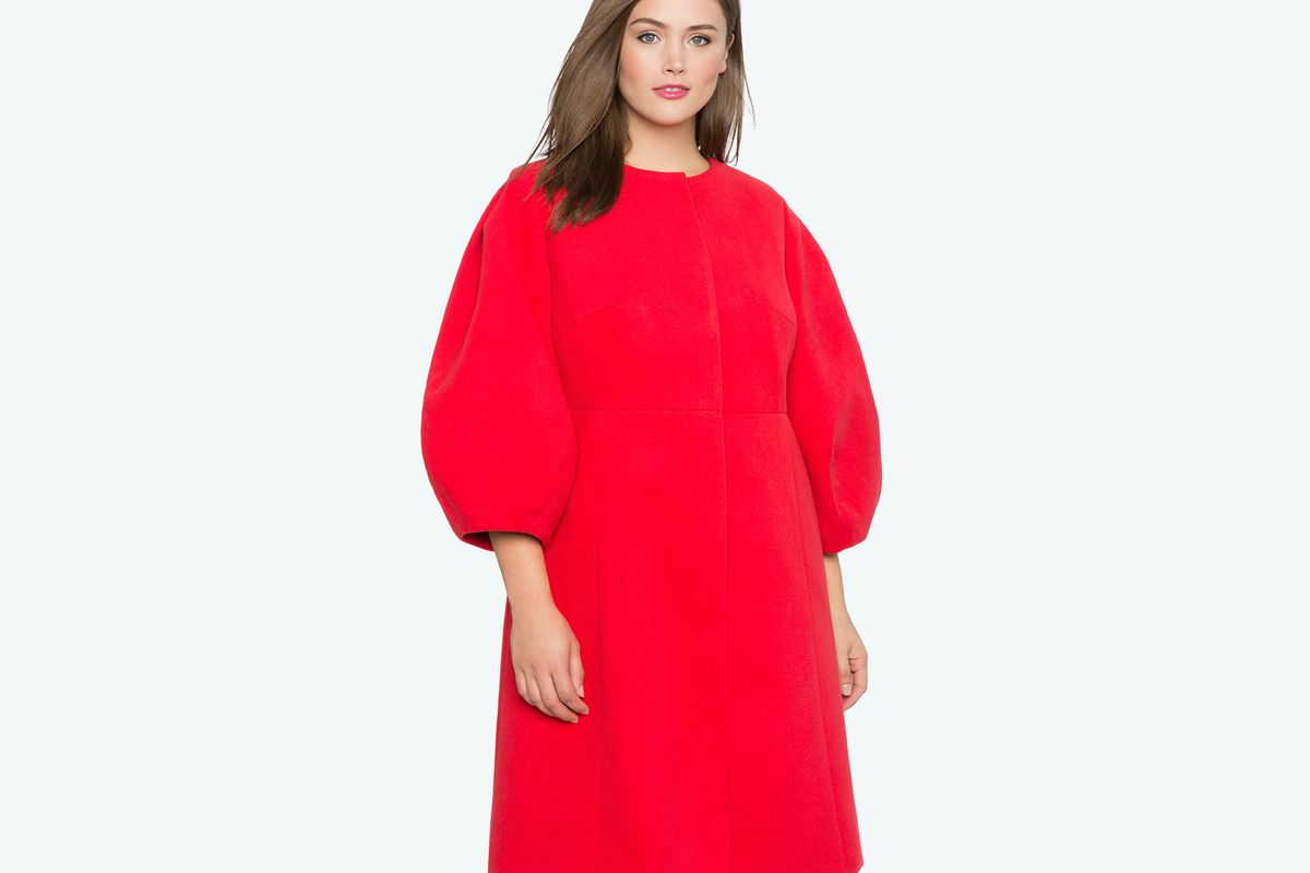 A model in a bright red sculptural coat