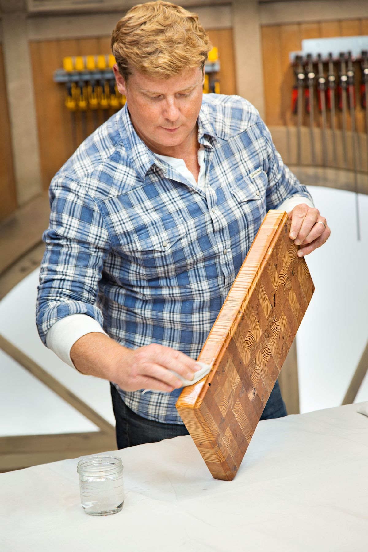 Person coating the end grain cutting board with food grade oil.
