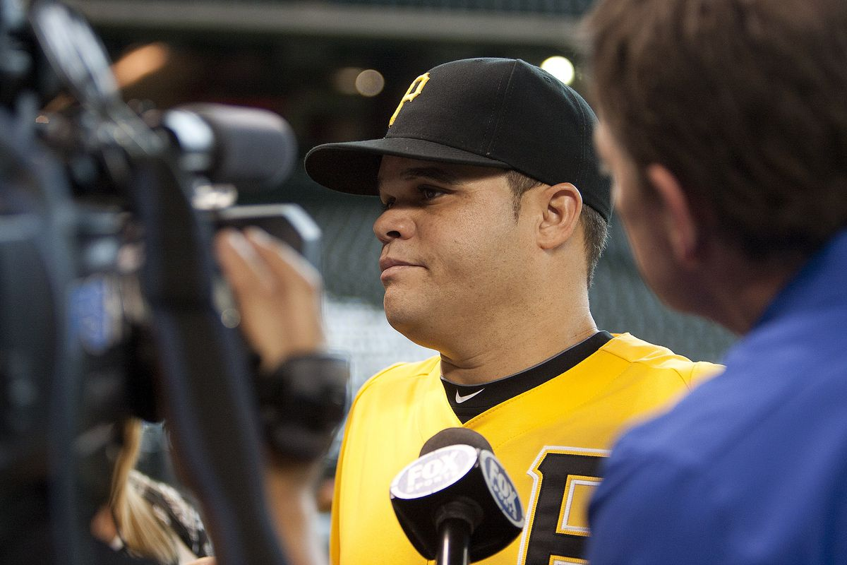 HOUSTON TX - JULY 26:  Wandy Rodriguez #51 of the Pittsburgh Pirates speaks with the media as he returns to Houston as a Pittsburgh Pirate at Minute Maid Park on July 26, 2012 in Houston, Texas. (Photo by Bob Levey/Getty Images)
