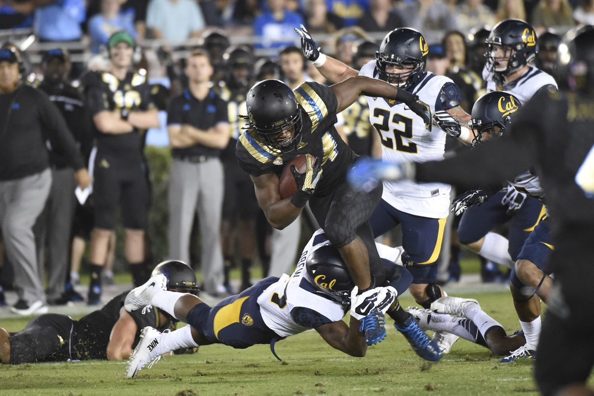Paul Perkins was gashing the Cal defense until a knee injury forced him out.