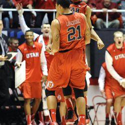 Utah Utes guard/forward Princeton Onwas (3) celebrates with Utah Utes forward Jordan Loveridge (21) after a basket and BYU timeout during a game at the Jon M. Huntsman Center on Saturday, December 14, 2013.