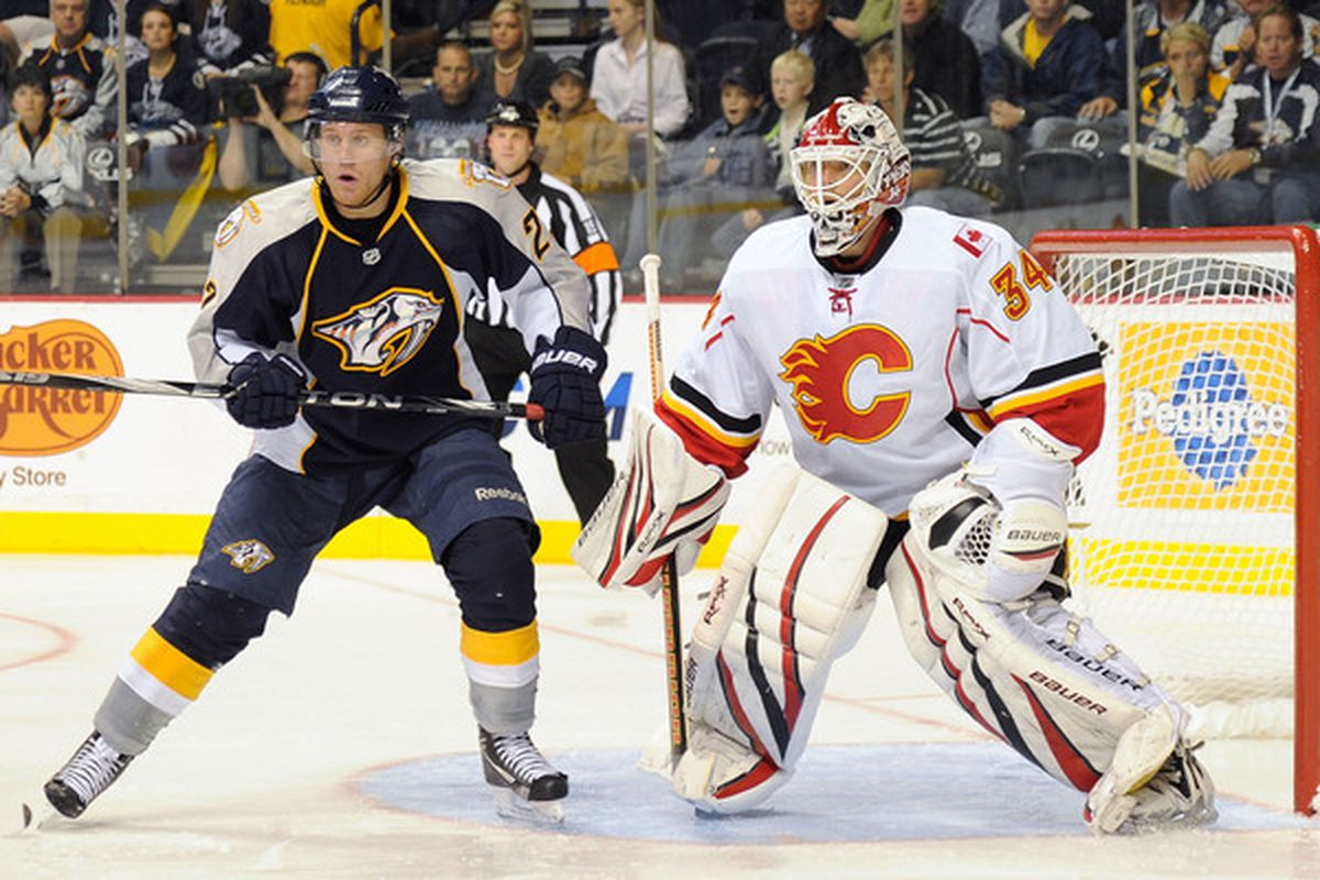 NASHVILLE TN - OCTOBER 19:  Right wing Patric Hornqvist #27 of the Nashville Predators gets position in front of goalie Miikka Kiprusoff #34 of the Calgary Flames on October 19 2010 in Nashville Tennessee.  (Photo by Frederick Breedon/Getty Images)