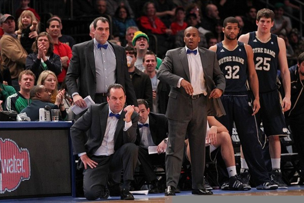Feb 25, 2012; New York, NY, USA;  Notre Dame Fighting Irish head coach Mike Brey and coaching staff react as St. John's scores during the second half at Madison Square Garden.  St John's won 61-58.  Mandatory Credit: Anthony Gruppuso-US PRESSWIRE