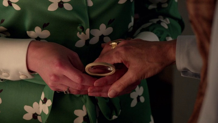 Pima clutches at Peggy's hand on Mad Men.