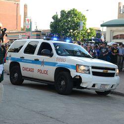 6:31 p.m. Motorcade arrives -