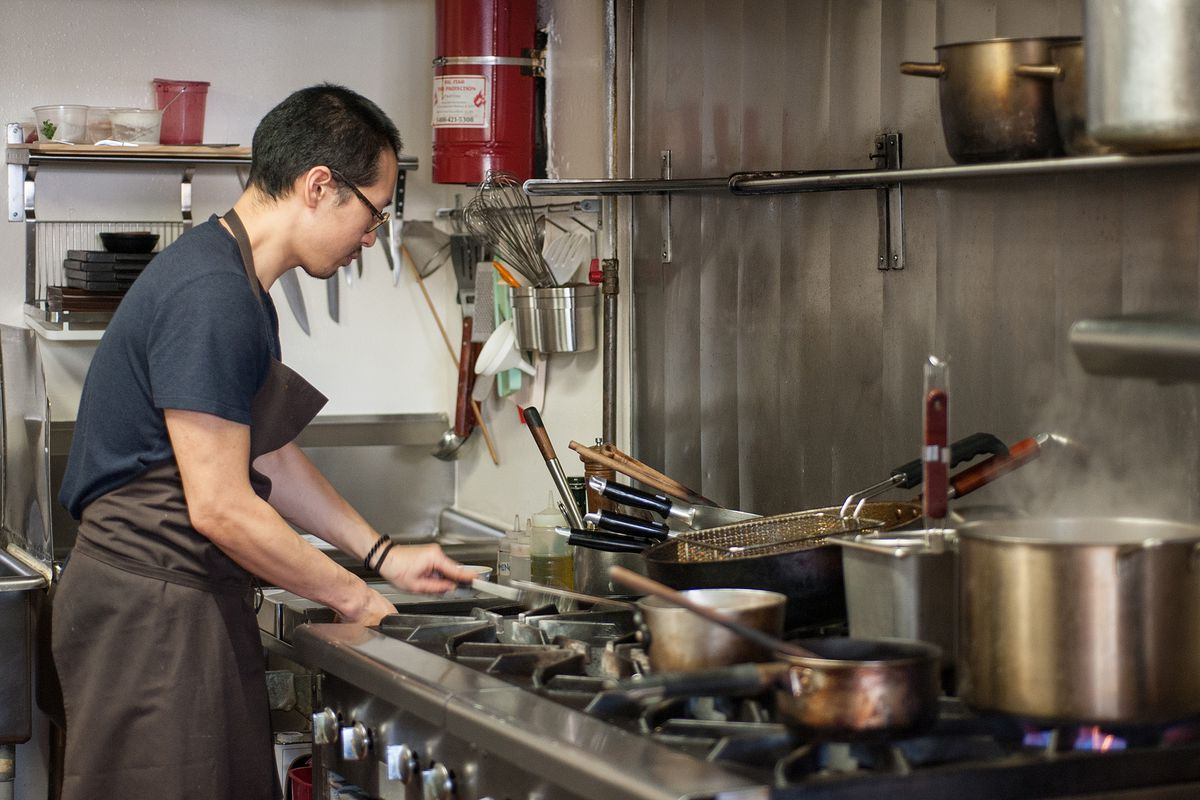 Kwang Uh cooking at the old Baroo over steel stoves.