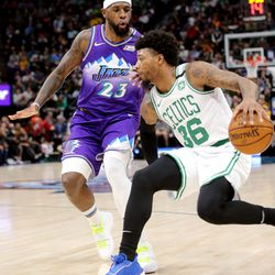 Utah Jazz forward Royce O'Neale (23) defends Boston Celtics guard Marcus Smart (36) as the Utah Jazz and the Boston Celtics play an NBA basketball game at Vivint Arena in Salt Lake City on Wednesday, Feb. 26, 2020.
