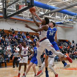 Curie's DaJuan Gordon (3) makes his way to the basket New Trier's Sam Silverstein (20), Friday 12-28-18. Worsom Robinson/For Sun-Times
