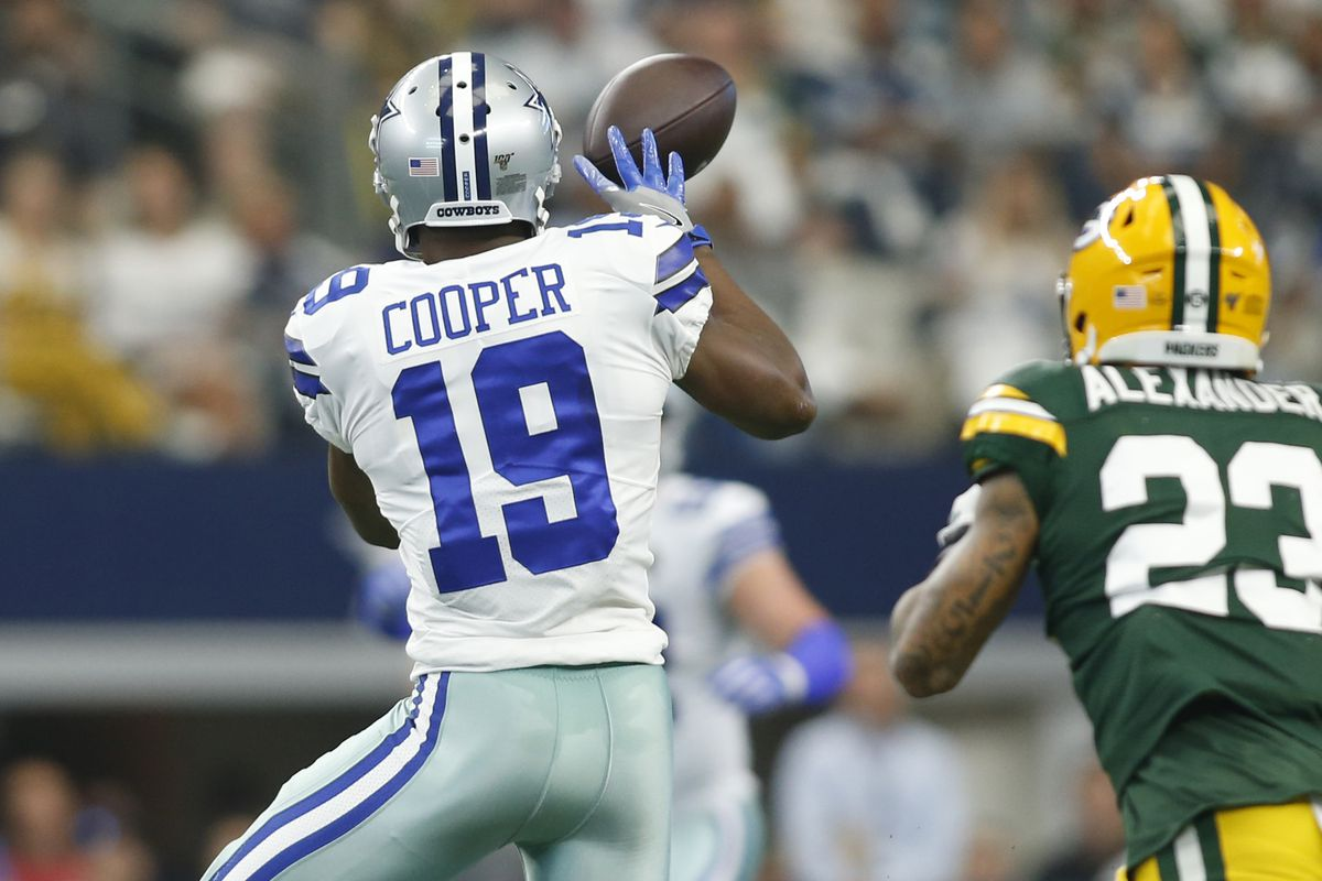 Dallas Cowboys wide receiver Amari Cooper catches a pass in the first quarter against Green Bay Packers cornerback Jaire Alexander at AT&T Stadium.