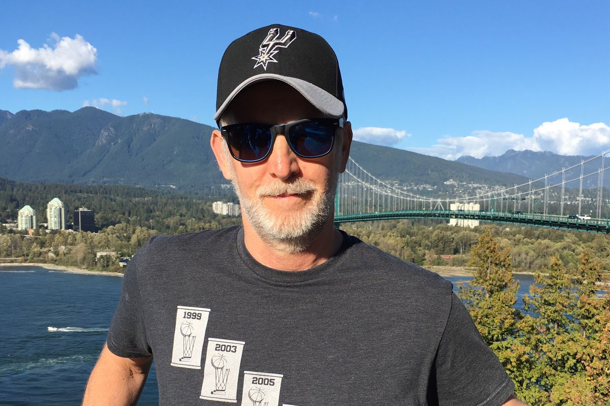 The author, in his Spurs shirt and cap