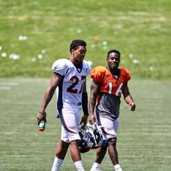 Broncos CB Brendan Langley and WR Isaiah McKenzie make their way to the locker room after practice.