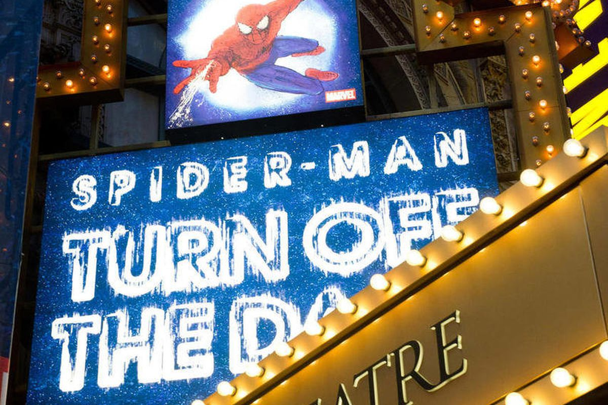 """FILE - In a Dec. 22, 2010 photo, the marquee for the Broadway musical """"Spider-Man Turn: Off the Dark"""" is illuminated outside the Foxwoods Theatre on West 42nd Street in New York. A stuntman who claims he sustained a concussion and two holes in his knees w"""