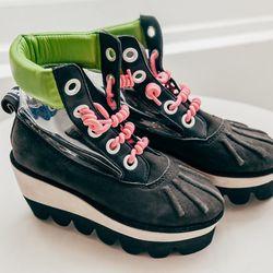 """<b>Degen</b> Slimemold boots, <a href=""""http://shop.bullettmedia.com/p/slimemold-boots/"""">$225</a>"""