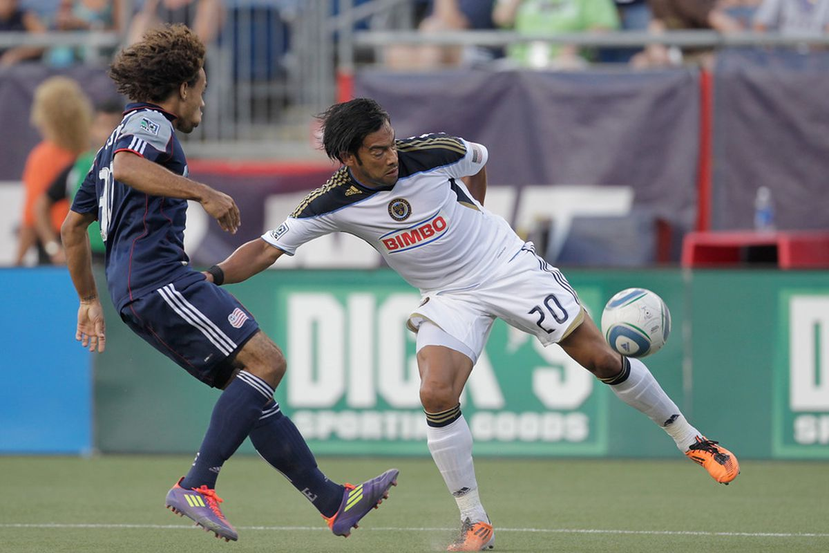 FOXBORO, MA - JULY 17:  Carlos Ruiz #20 of the Philadelphia Union battles Kevin Alston #30 of the New England Revolution at Gillette Stadium on July 17, 2011 in Foxboro, Massachusetts. (Photo by Jim Rogash/Getty Images)