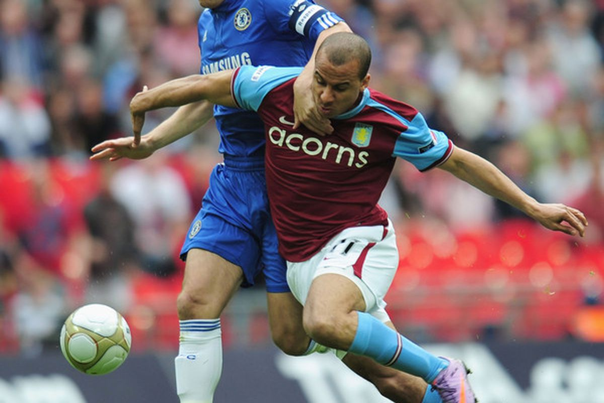 """LONDON, ENGLAND - APRIL 10:  """"Dad of the Year"""" John Terry lays hands on Gabriel Agbonlahor, mistaking him for a teammate's wife. (Photo by Shaun Botterill/Getty Images)"""