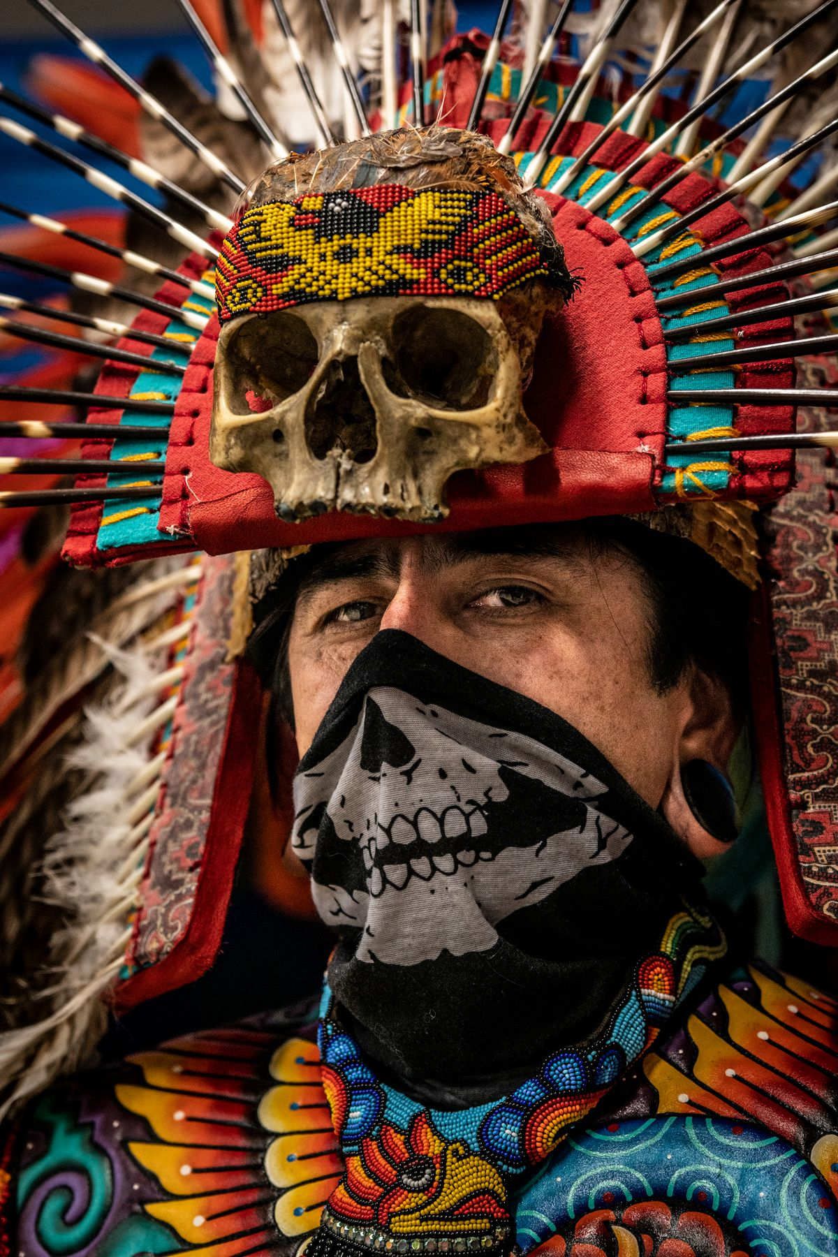 Dancer Gustavo Arias performed at Mixteca Organization in Atlanchinolli regalia, an Aztec metaphor for war that uses the polarities between water and fire for symbolism, Oct. 30 2020.