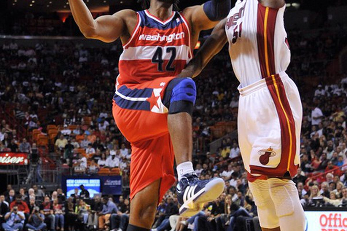 April 21, 2012; Miami, FL, USA; Washington Wizards center Nene (42) drives to the basket as Miami Heat center Joel Anthony (50) defends during the first half at American Airlines Arena. Mandatory Credit: Steve Mitchell-US PRESSWIRE