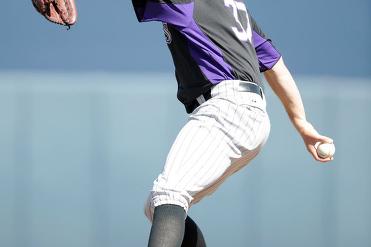 Greg Reynolds of the Colorado Rockies pitches against the San Diego Padres during spring training at Peoria Stadium on March 2, 2011 in Peoria, Arizona.  (Photo by Harry How/Getty Images)