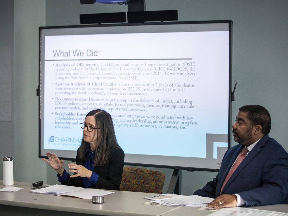 Dana Weiner (left), policy fellow at Chapin Hall at the University of Chicago, and Illinois Department of Children and Family Services Acting Director Marc Smith discuss a review of the DCFS Intact Family Services program, during a press event, Monday mor