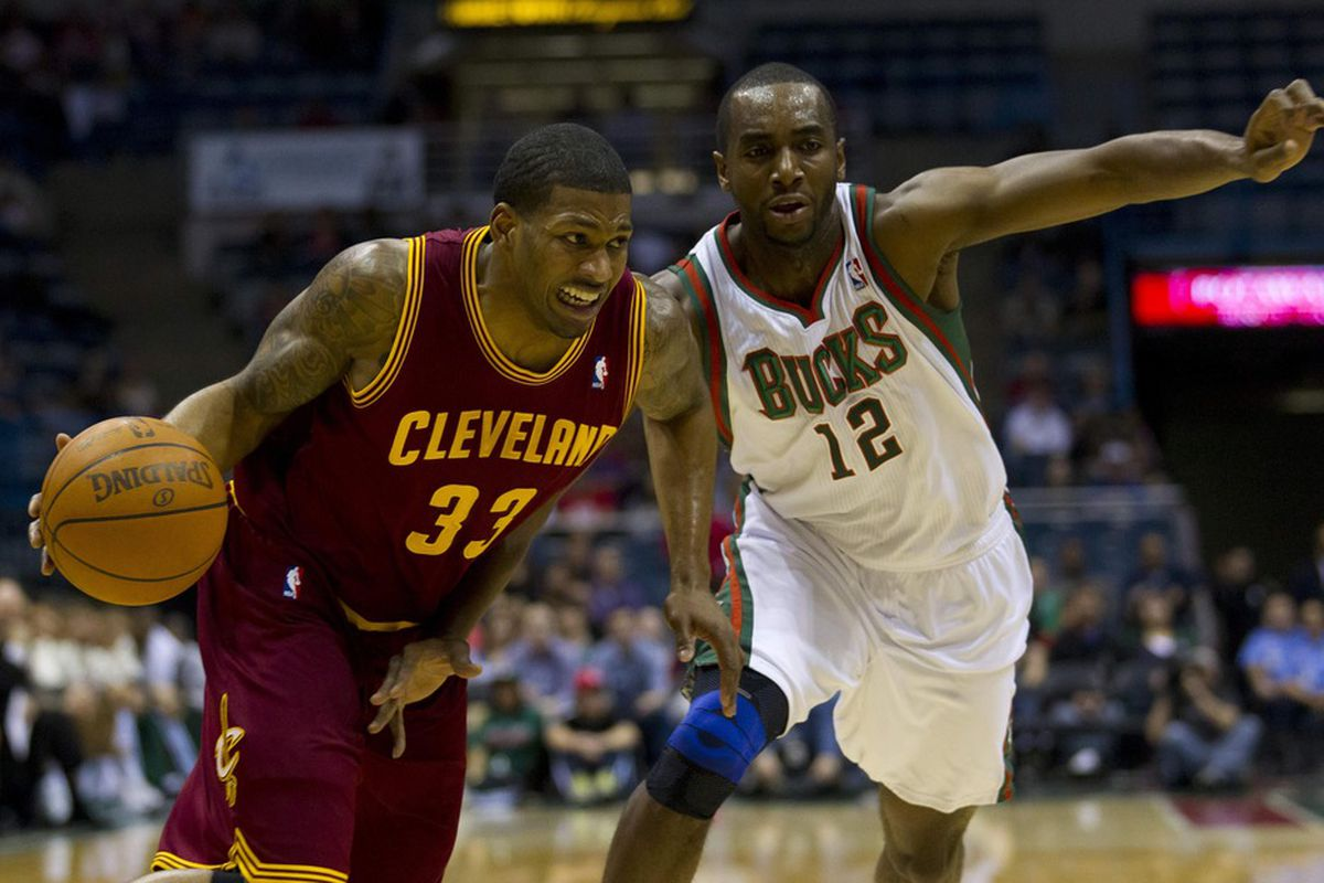 Apr 4, 2012; Milwaukee, WI, USA;  Cleveland Cavaliers forward Alonzo Gee (33) drives against Milwaukee Bucks forward Luc Richard Mbah a Moute (12) during the first quarter at the Bradley Center.  Mandatory Credit: Jeff Hanisch-US PRESSWIRE