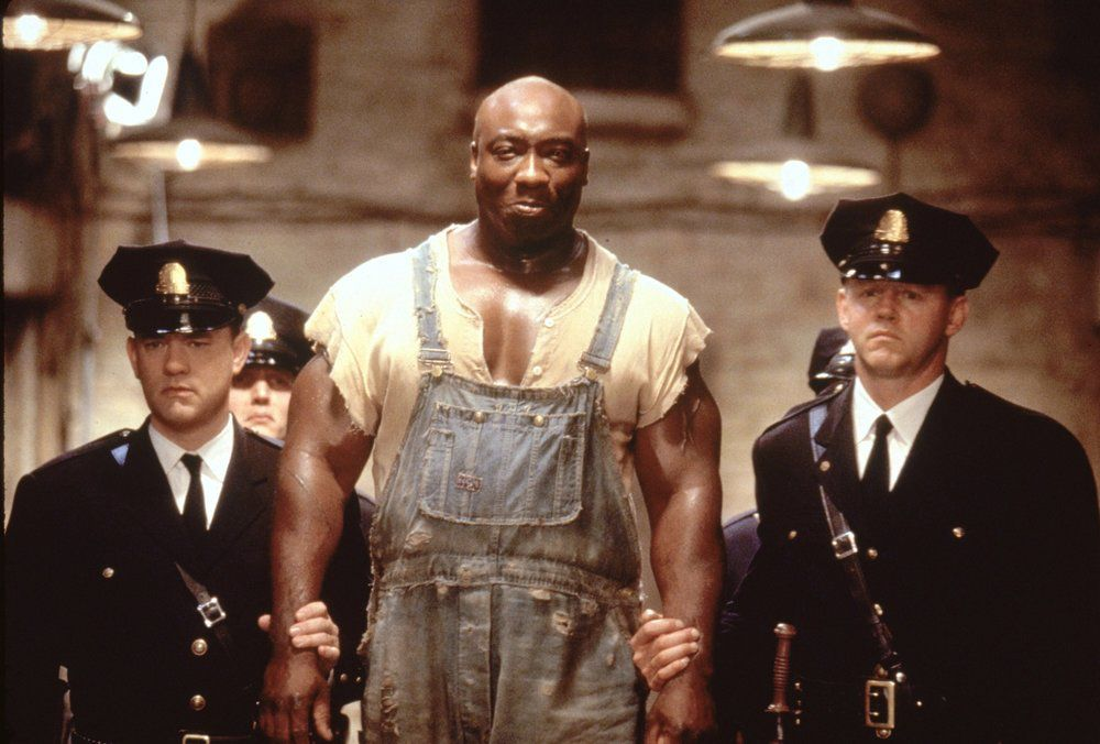 Tom Hanks and Michael Clarke Duncan as Paul Edgecomb and inmate John Coffrey in The Green Mile