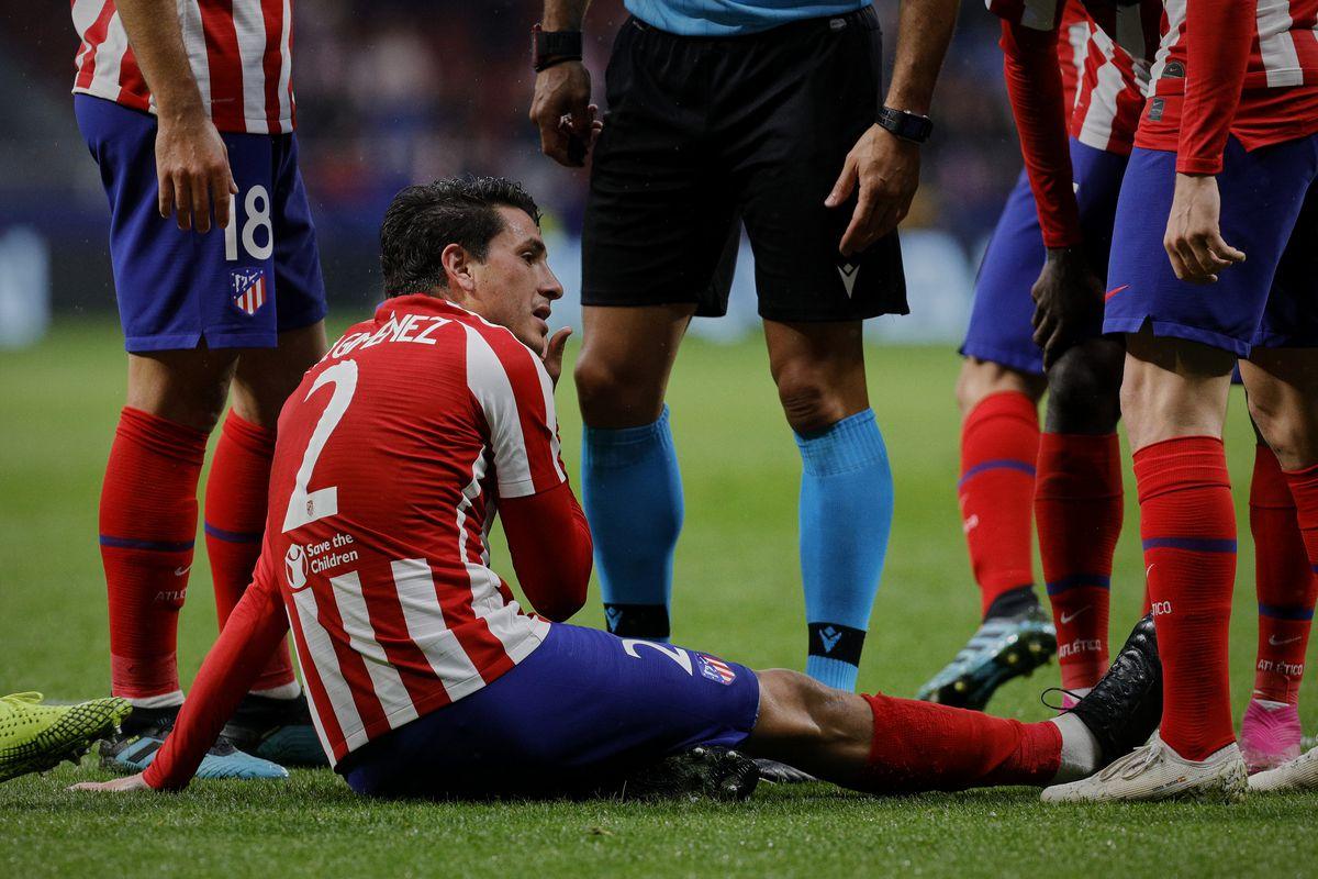 Jose Maria Gimenez of Atletico de Madrid is being injured...
