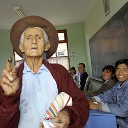 A peasant woman shows her finger, marked with ink to show she voted, June 3, 2001 in Ayacucho, Peru.