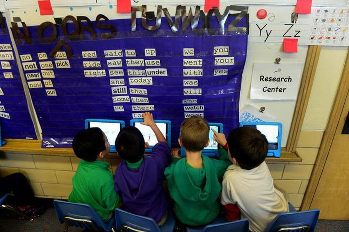 Students work on their iPads at Denver's Ashley Elementary school in 2015.