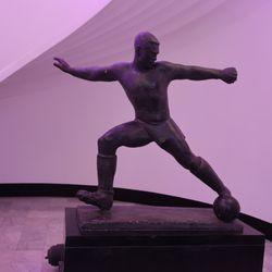 Footballer statue in lobby
