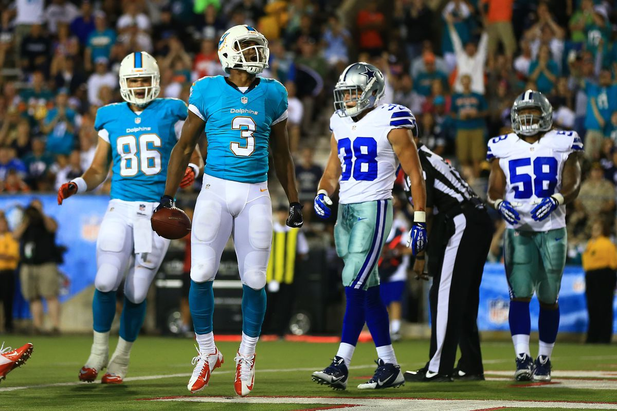 Dolphins' Player celebrates after scoring touchdown in Hall-of-Fame Game.