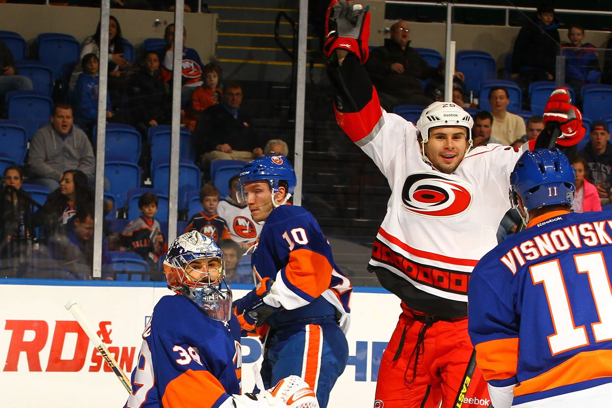 Tim Wallace celebrates a goal against the Islanders on February 11, 2013