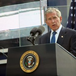 FILE - In this Sept. 11, 2011 file photo, former U.S. President George W. Bush addresses those attending the 10th anniversary commemoration of the terrorist attacks on the World Trade Center in New York. For the first time, elected officials won't be allowed to speak Tuesday, Sept. 11, 2012, at  an occasion that has allowed them a solemn turn in the spotlight, a change made in the name of avoiding politics, but rapped by some as a political move in itself.