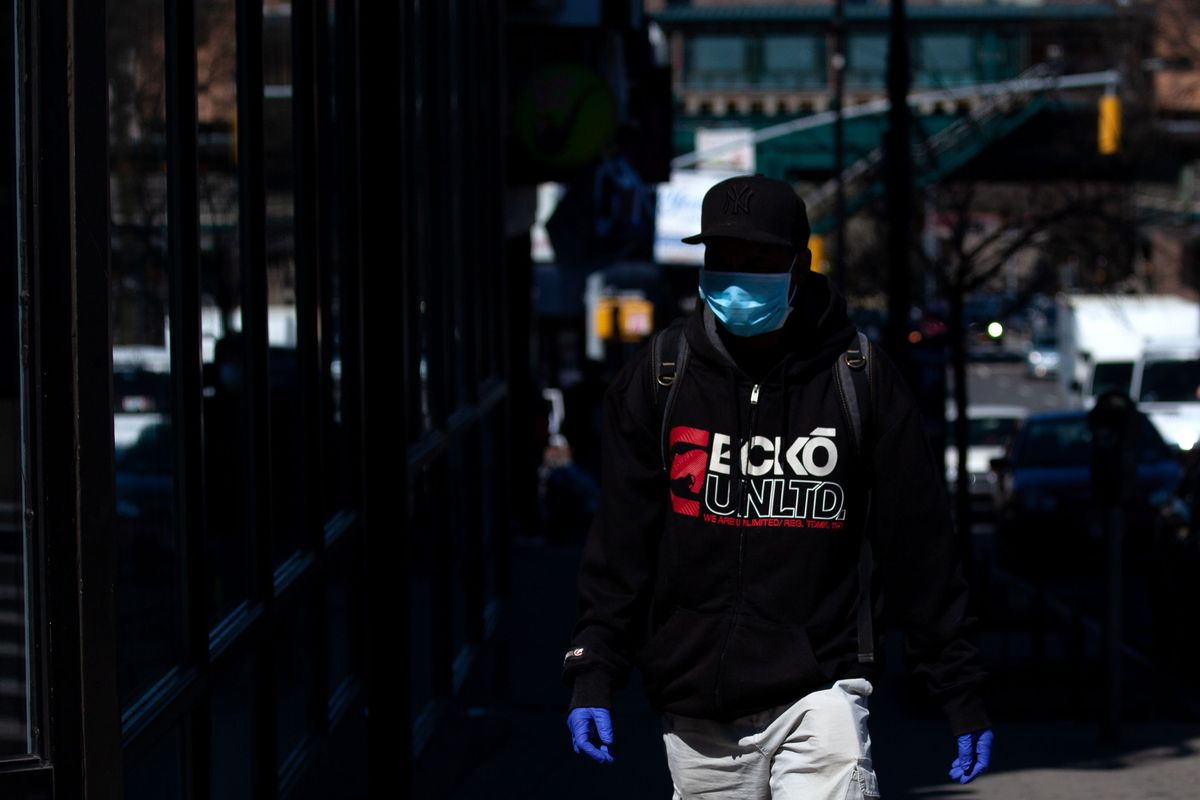A man wears a mask in the South Bronx during the coronavirus outbreak.