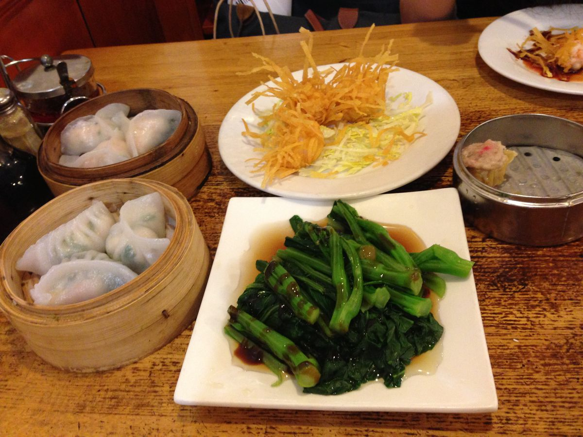 A spread of dim sum dishes, including several dumplings