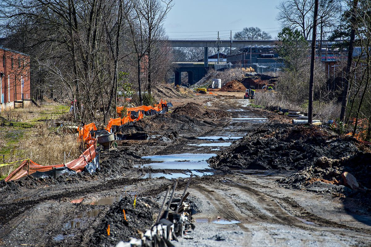 The Westside Trail is under construction. Right now it's a mud pit but eventually it will connect Gordon White Park to Adair Park using the old railroad corridor.