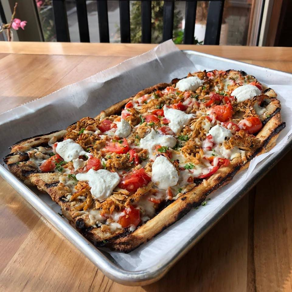 A pizza special at Daddy Jones (shredded chicken, tomato sauce, tzatziki, and salsa)