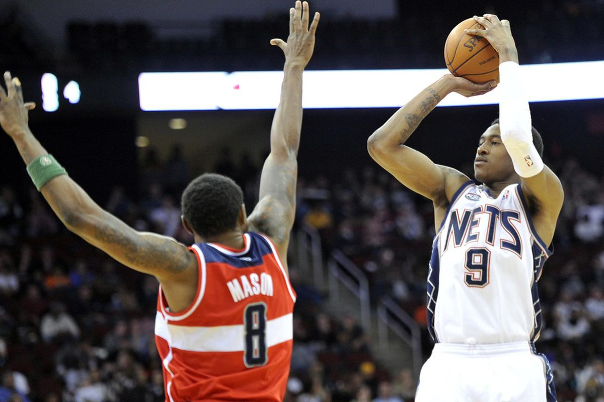 Apr 6, 2012; Newark, NJ, USA;  New Jersey Nets forward MarShon Brooks (9) takes a shot over Washington Wizards  Roger Mason (8) during the first half at  the Prudential Center.  Mandatory Credit: Joe Camporeale-US PRESSWIRE