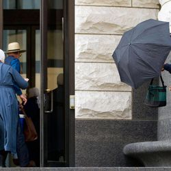 Amish enter the U.S. Federal Courthouse in Cleveland on Thursday, Sept. 20, 2012.  The jury will begin their fifth day of deliberations in the trial of 16 Amish people accused of hate crimes in hair- and beard-cutting attacks against fellow Amish in Ohio.
