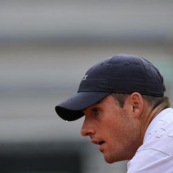 John Isner of US, is concentrated on the match  as a sweat drop clings to his peaked cap  during his Davis Cup World Group Semi-final tennis match  against Spain's David Ferrer, in Gijon, northern Spain, Sunday, Sept.16 , 2012. Ferrer won 6-7,  6-3,  6-4, 6-2.