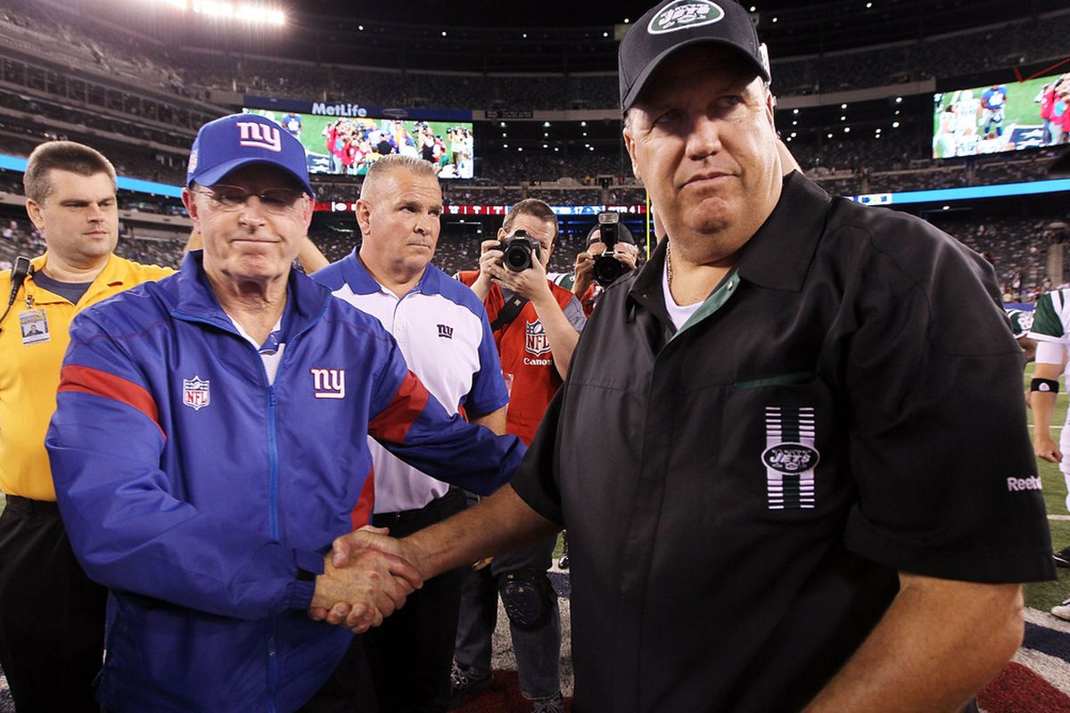 Head coach Rex Ryan of the New York Jets greets head coach Tom Coughlin of the New York Giants after their pre season game on August 29, 2011 at MetLife Stadium in East Rutherford, New Jersey.  (Photo by Jim McIsaac/Getty Images)