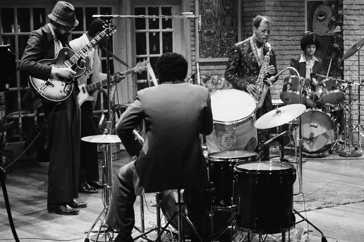Ornette Coleman (center stage, between drummers) performs on Saturday Night Live in 1979.