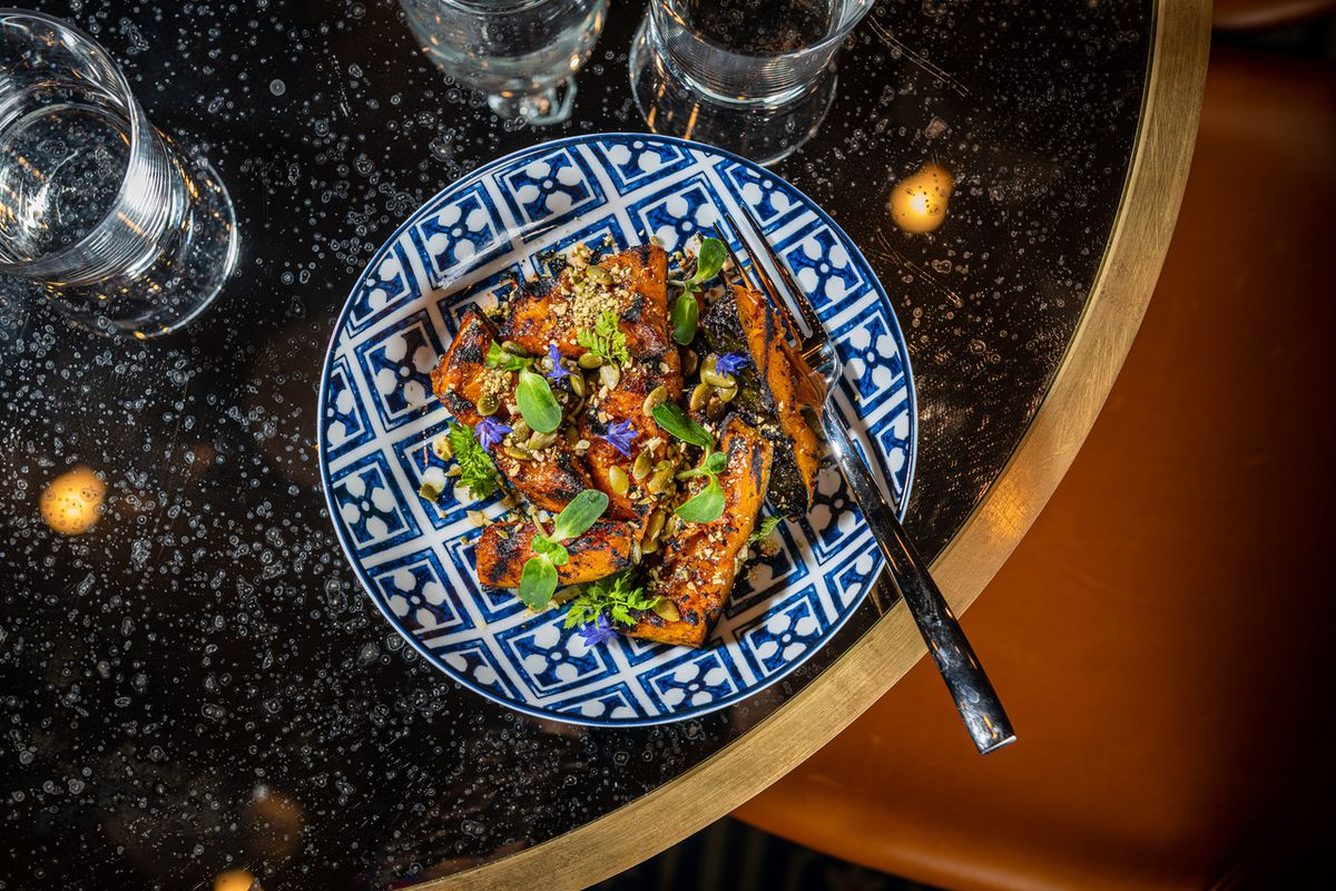 A hot meze features grilled squash topped with toasted pepita seeds