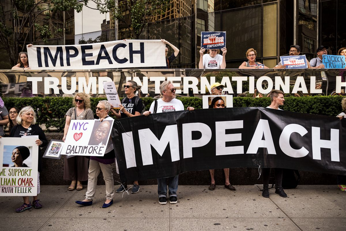 Demonstrators rally to support impeachment of President Trump.
