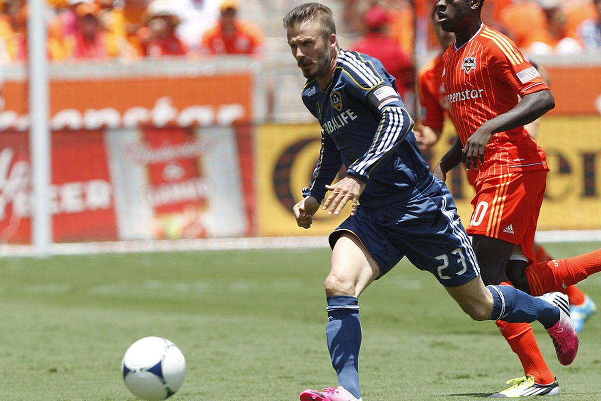 HOUSTON, TX - MAY 26:  David Beckham #23 of the Los Angeles Galaxy brings the ball up the field against the Houston Dynamo at BBVA Compass Stadium on May 26, 2012 in Houston, Texas.  (Photo by Bob Levey/Getty Images)