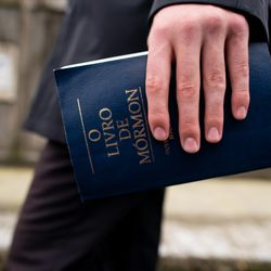 Elder Tanner McKee, a missionary for The Church of Jesus Christ of Latter-day Saints, walks the streets of Paranaguá, Brazil, with a Book of Mormon in hand on Sunday, June 2, 2019.