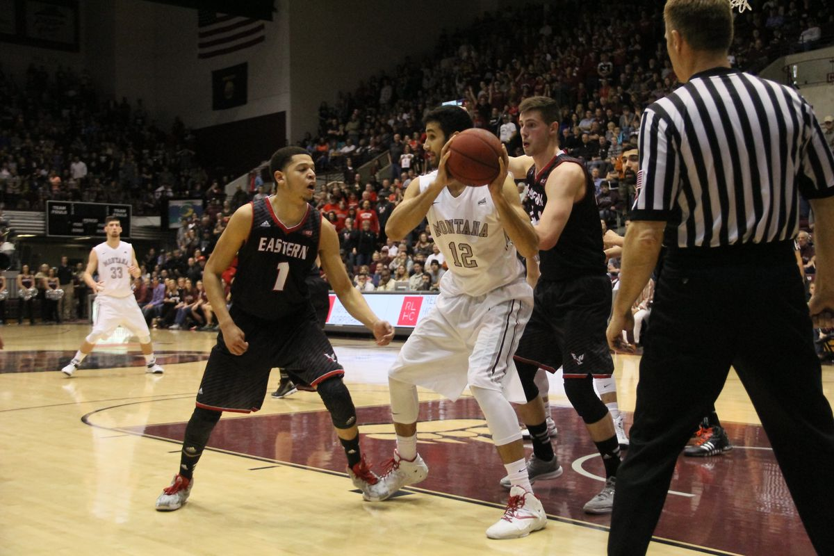 Tyler Harvey (1) moments before stripping Martin Breunig (12) in a key moment of Eastern Washington's comeback win over Montana in the 2015 Big Sky championship game.