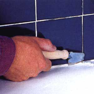 <p>CUT AWAY THE old caulk from around the top of the tub. Then thoroughly clean the joint of all grime, dust and soap buildup.</p>