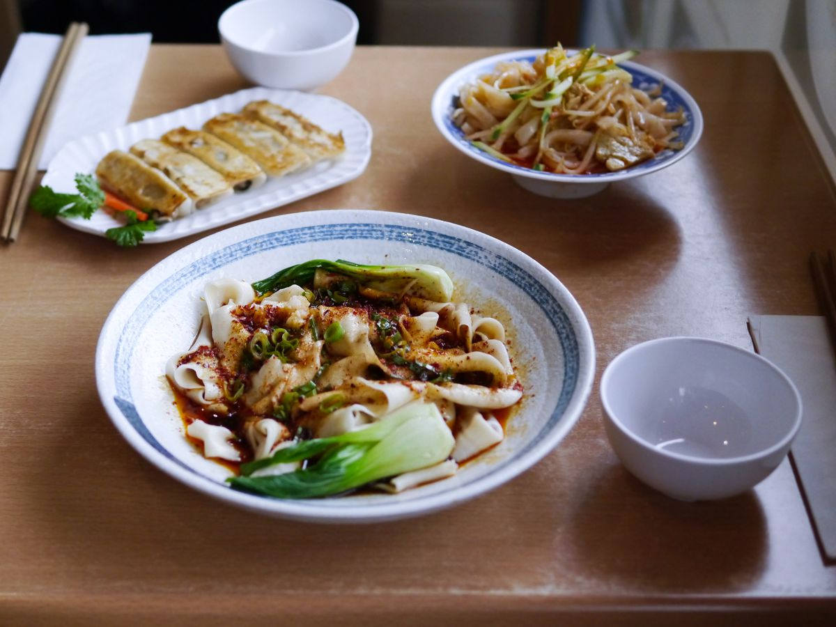 From top left: pot-sticker dumplings, 'cold skin' noodles, and biang biang noodles at Xi'an Impression, a Xi'an Chinese restaurant in Islington