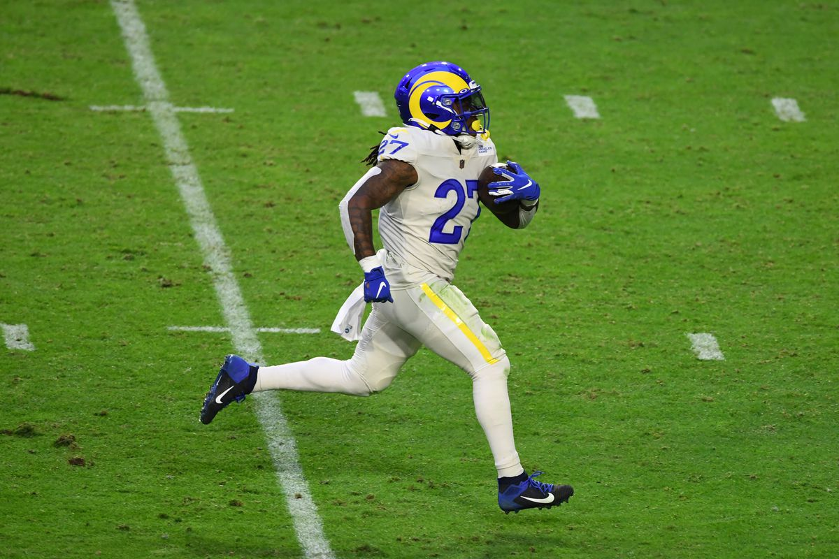 Darrell Henderson Jr #27 of the Los Angeles Rams scores a rushing touchdown against the Arizona Cardinals at State Farm Stadium on December 06, 2020 in Glendale, Arizona.
