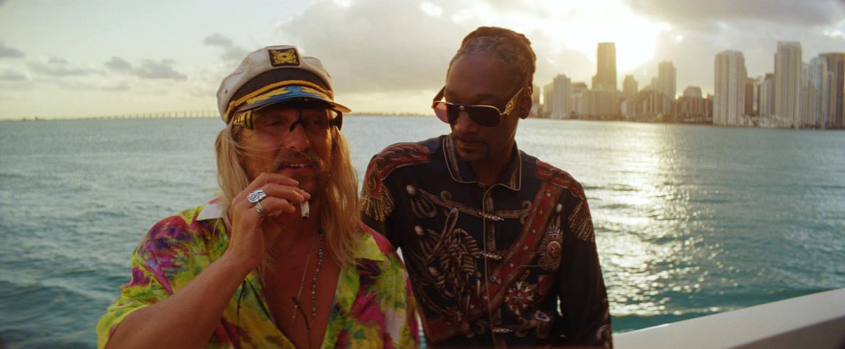 Moondog (McConaughey) and Lingerie (Snoop Dogg) out on the water.